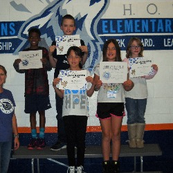 Students displaying certificates for HOWLS mindset.